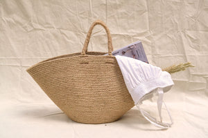 jute bag with clothes inside