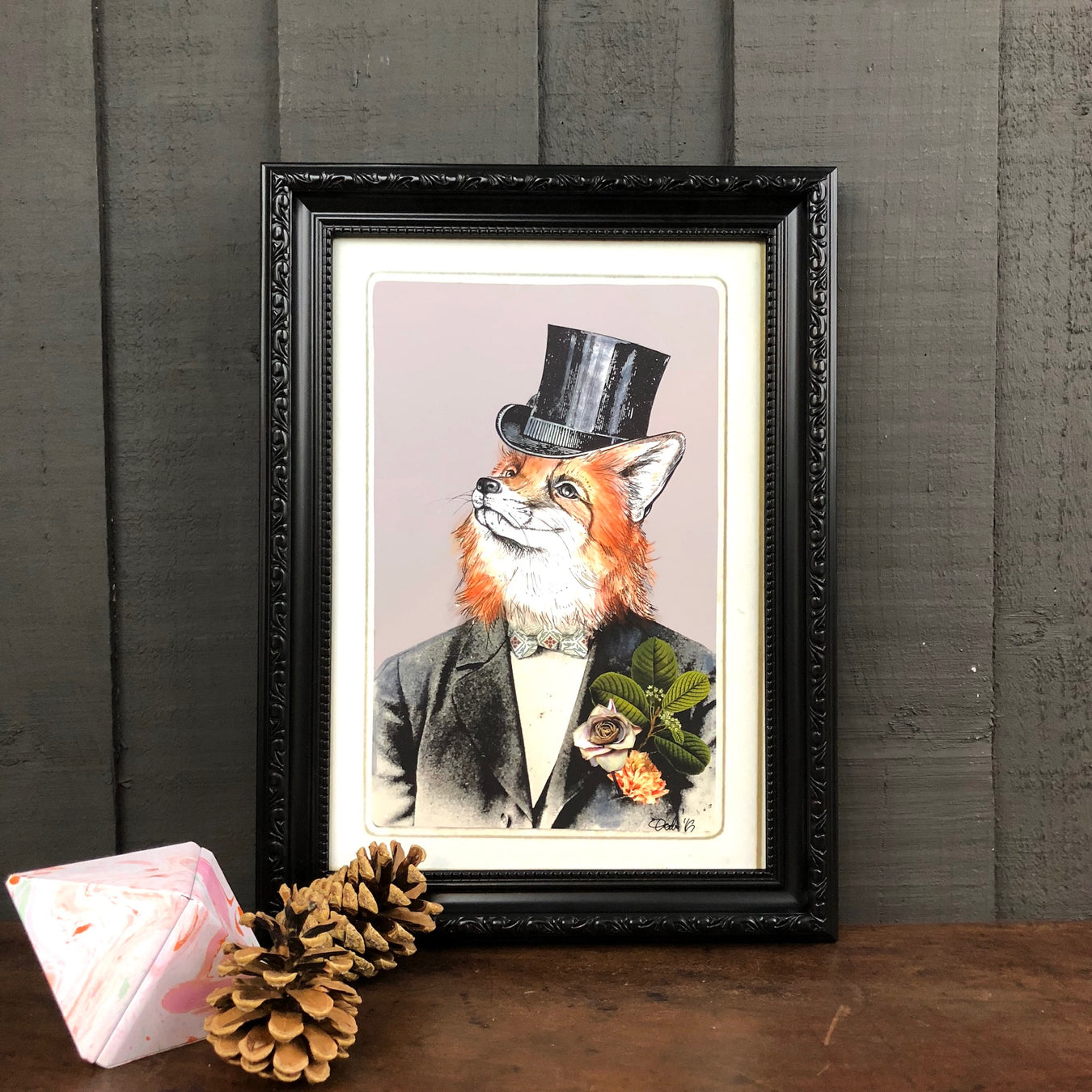 Framed picture of a dapper fox in a tophat