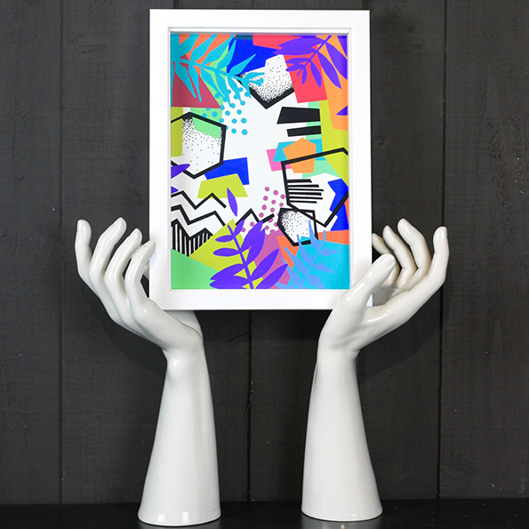Abstract gallery wall art held up by hands