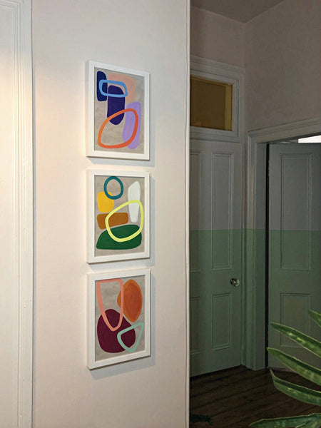 Three Abstract Art pop prints on the wall