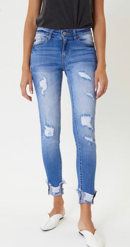 Mid Rise Medium Wash Distressed Skinny