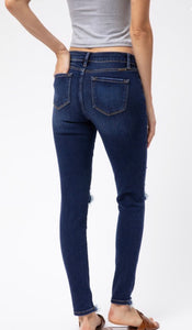 Mid Rise Distressed Super Skinny