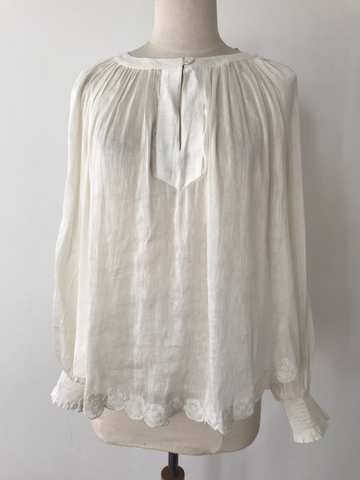 silk and linen peasant shirt with embroidery around the hem, and on the sleeves. Ivory color