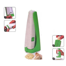 Load image into Gallery viewer, Hand held Garlic Cube Press + FREE Foldable Chopping Board