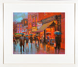 A framed print of a vibrant painting of people on Little Catherine Street in Limerick