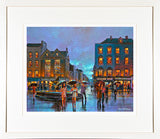 A framed print of a painting of an a crowded evening on Grand Parade, Cork city centre