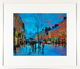 A framed print of a painting of the centre of Nenagh Town, County Tipperary