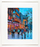 A framed print of a painting of people meeting under Eason's Clock in O'Connell Street, Dublin