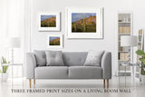 Three framed print sizes on a living room wall