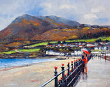 A painting of a couple kissing under a red umbrella by the Promenade in Bray, Co Wicklow