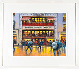 A framed print of a painting of people walking by Bewleys iconic café on Grafton Street, Dublin