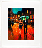 A framed print of a vibrant painting of two lovers out for the night sheltering under a green umbrella