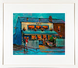 A framed print of a painting of the Bath Bar in a residential area of Sandymount