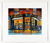A framed print of a painting of Butlers Café on the corner of South william Street, Dublin