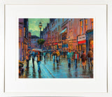 A framed print of a painting of a bustling Grafton Street in Dublin city centre