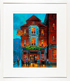 A framed print of a painting of The Stags Head Pub at the back of Dame Street, Dublin