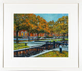 A framed print of a painting of the Grand canal banks in Dublin City centre