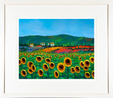 A framed print of the painting Sunflowers mounted in a cream mount