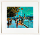 A framed print of a painting of a couple arm in arm walking along the promenade by the River Thames in London