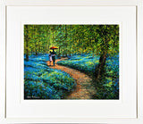 A framed print of a painting of two lovers with an umbrella walking among the bluebells