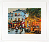 A framed print of a painting of cafes in the Montmartre area of Paris, France