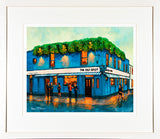 A framed print of a painting of outside the Old Spot Pub in Sandymount, Dublin