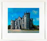 A print of a painting of Kinnitty Castle, Co Offaly, Ireland, framed and mounted in a cream frame