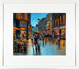 A print of a painting titled Grafton Street Moment with a cream mount and frame
