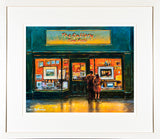 Framed print of two lovers gazing at the artwork on show in the big window of an art shop
