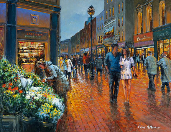 A painting of a young couple walking arm in arm down Grafton Street, Dublin in the evening glow.