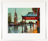 A framed print of a painting of the Clock Tower and Fountain landmark on the quayside of Waterford City