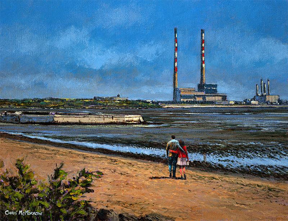 A couple take a leisurely stroll along the beach at Sandymount