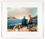 Framed print of two old guys sitting on a wall near the sea talking