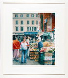 Print of a painting of the fruit and veg sellers on Moore Street, Dublin