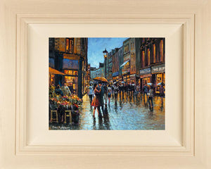 Acrylic painting on 18x14 inch canvas Acrylic painting featuring aq young couple embracing under an umbrella on Grafton Street, Dublin
