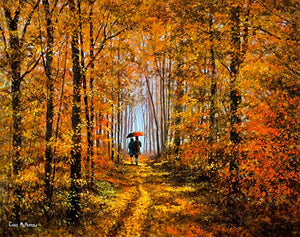 A couple taking a stroll in the woods, the reds and gold of autumn on display