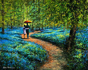 A couple walking under a red umbrella in a forest of bluebells