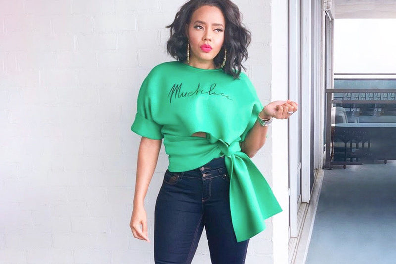 Angela Simmons On Mommy Duty in Her Muehleder Slashed Sweatshirt