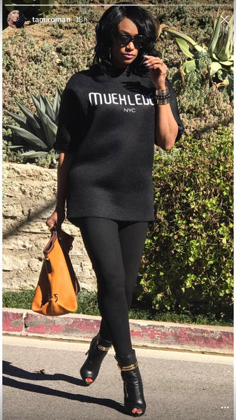 Tami Roman Muehleder sweatshirt black booties black leggings handbag
