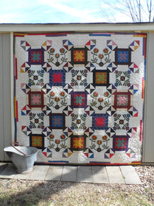 Scrappy lap quilt pattern with applique