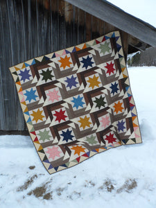 Scrappy lap quilt pattern by Snuggles Quilts