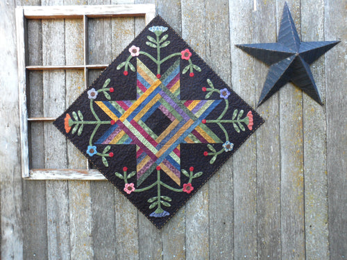 scrappy wall hanging table topper quilt pattern with applique
