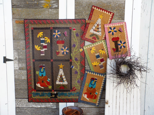 Wool applique on fabric quilt pattern
