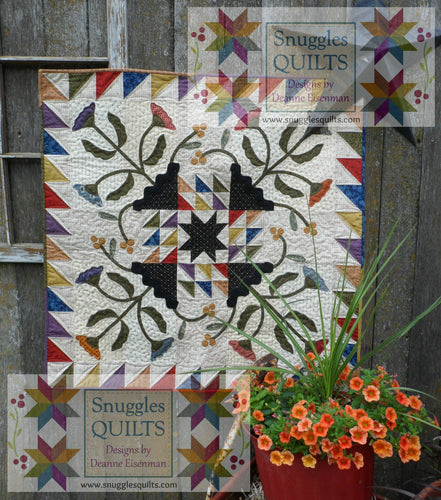 Scrappy quilt pattern for wall hanging or table topper with floral fabric applique