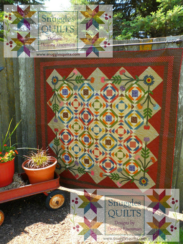 Scrappy lap quilt pattern with applique designed by Deanne Eisenman for Snuggles Quilts