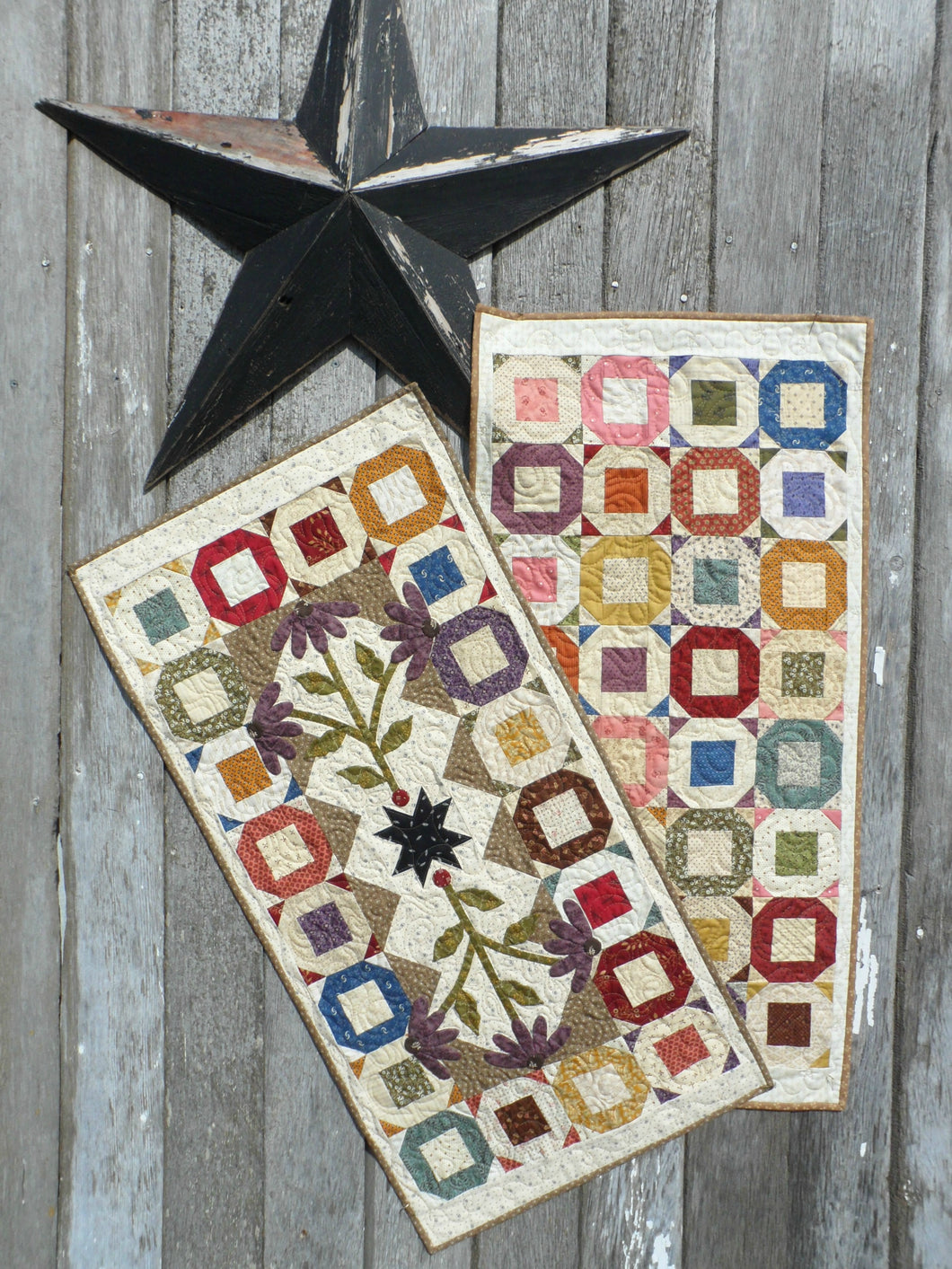 scrappy table runner quilt pattern with applique charm square friendly