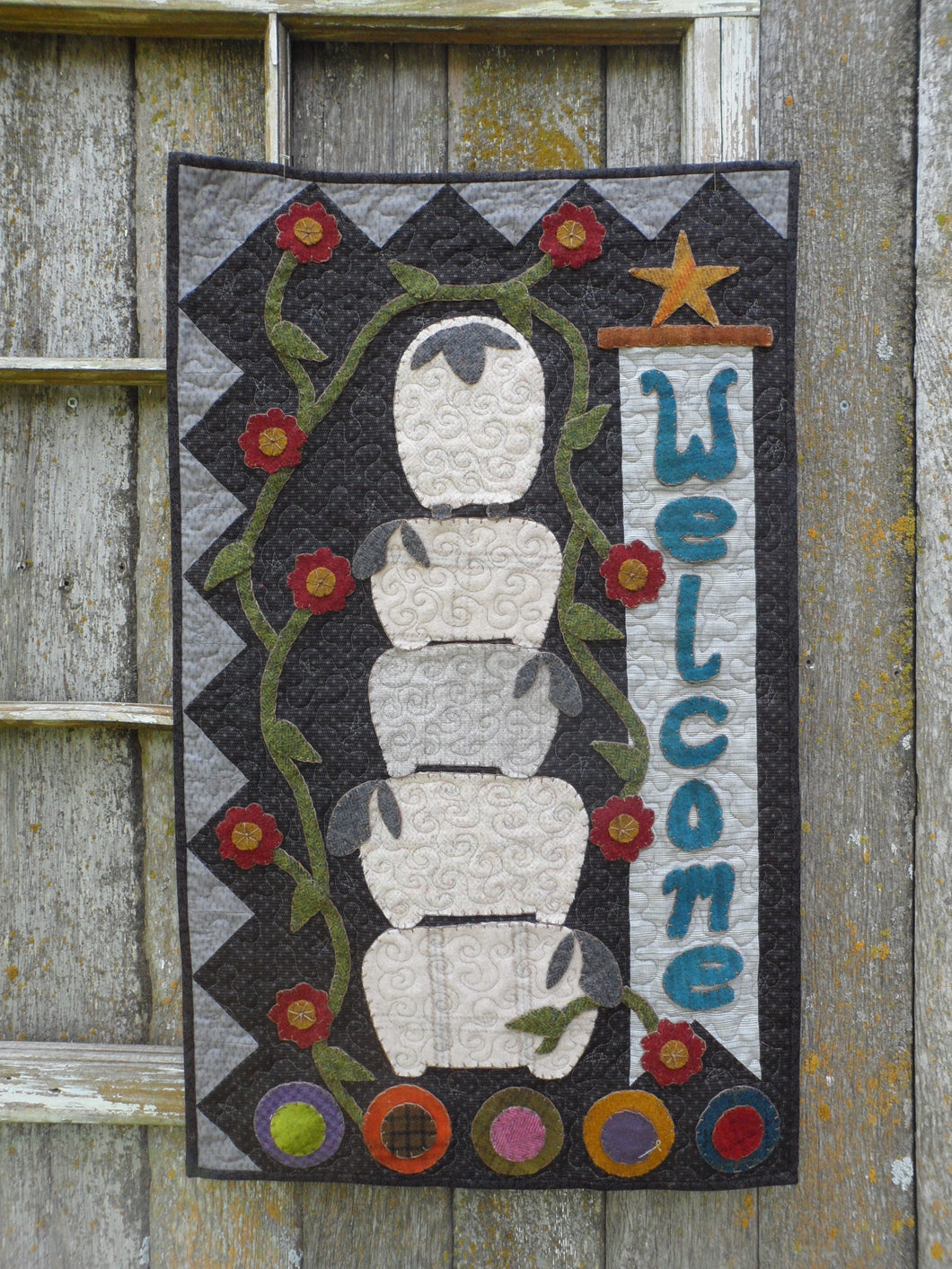 wool applique on fabric wall hanging welcome with sheep
