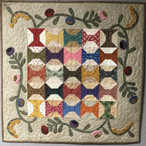 scrappy table topper with applique quilt pattern
