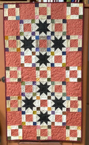 Crazy Eights scrappy table runner pattern designed by Deanne Eisenman for Snuggles Quilts