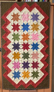 Skylight scrappy table runner quilt pattern designed by Deanne Eisenman for Snuggles Quilts